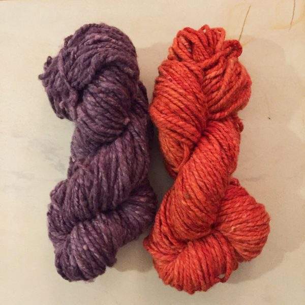 purple and orange wool yarn